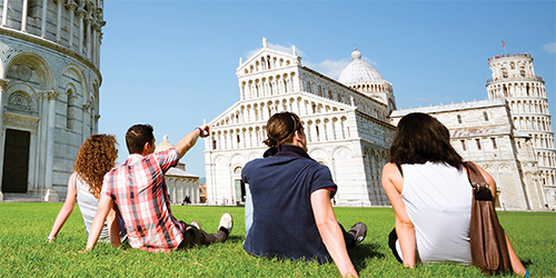 travelers in Italy at the Leaning Tower of Pisa CostSaver Trafalgar